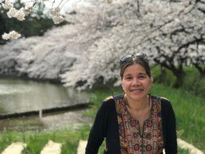 head shot of Frances Aparicio in front of trees