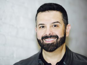 Head shot of Tony Mata, short hair and beard
