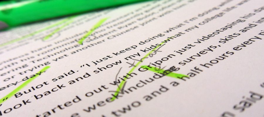 Green highlighter and paper with edited text