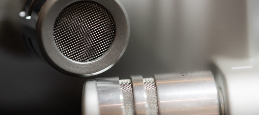 Two microphones attached to a digital audio recorder